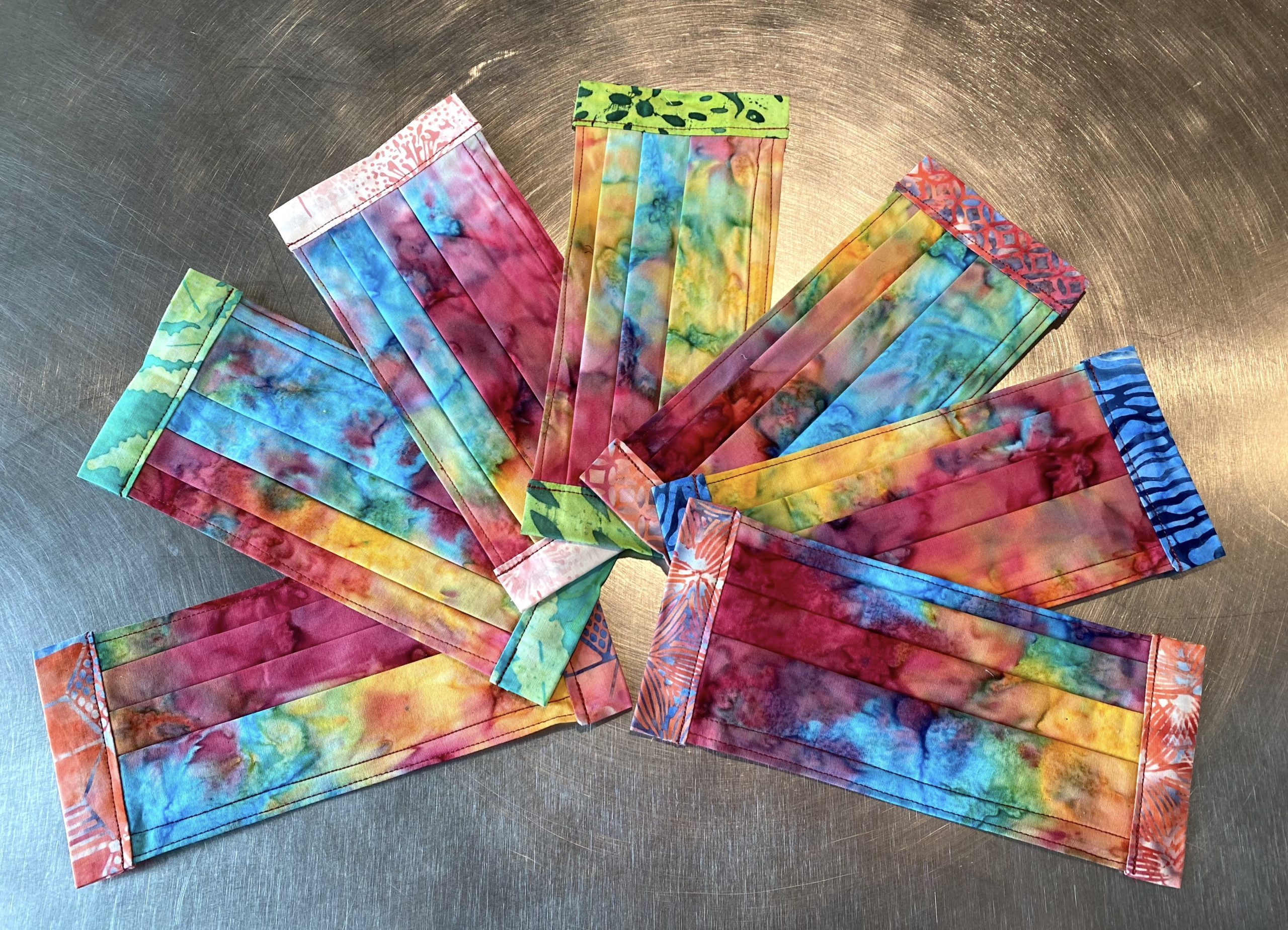 Rainbow Redux masks by Bozeman BAtiks